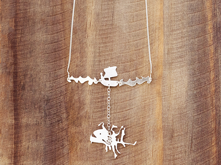 escapism sea monster boat man silver necklace