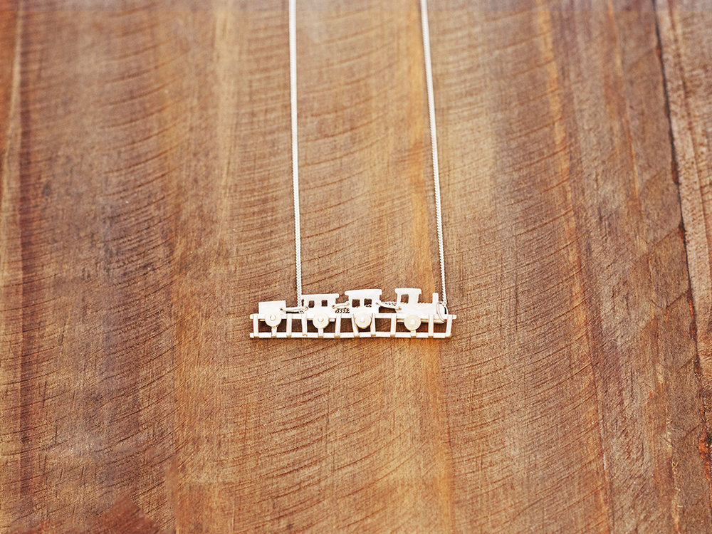 escapism train silver gold necklace