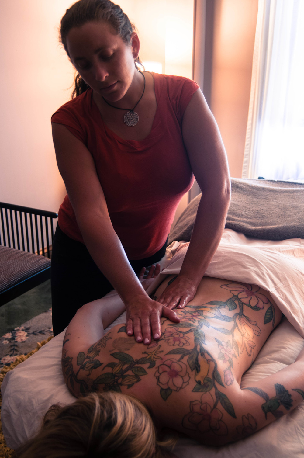 Sandra Benson, LMT working with a valued client.