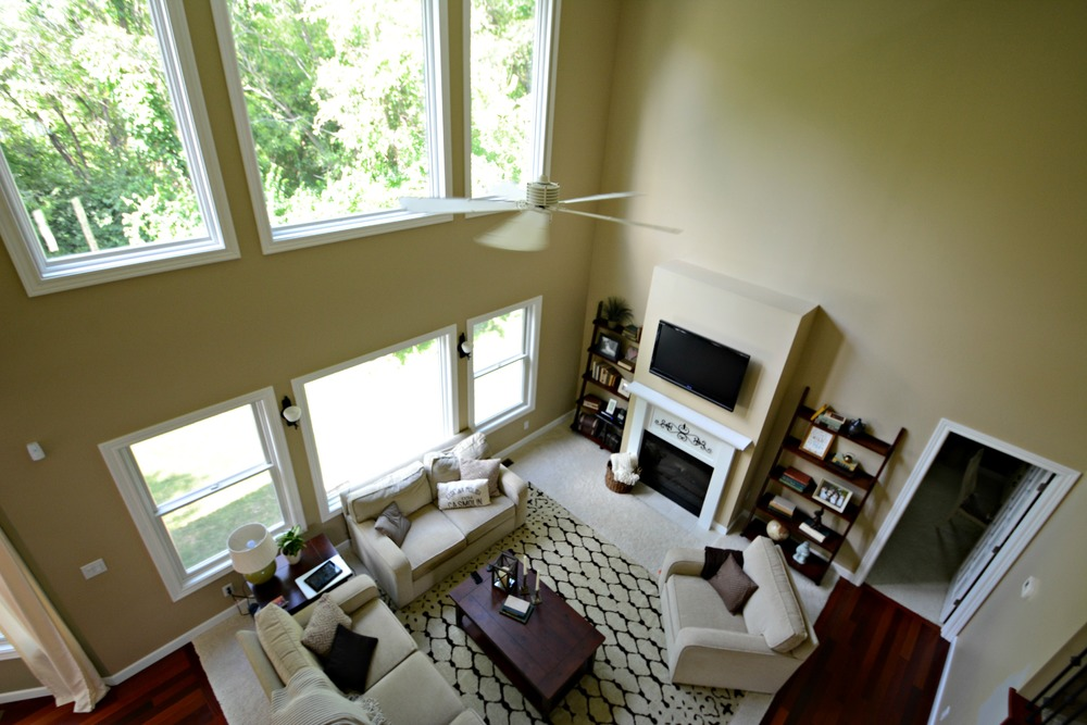 Two story wall molding decor and the dog for 2 story living room decorating ideas