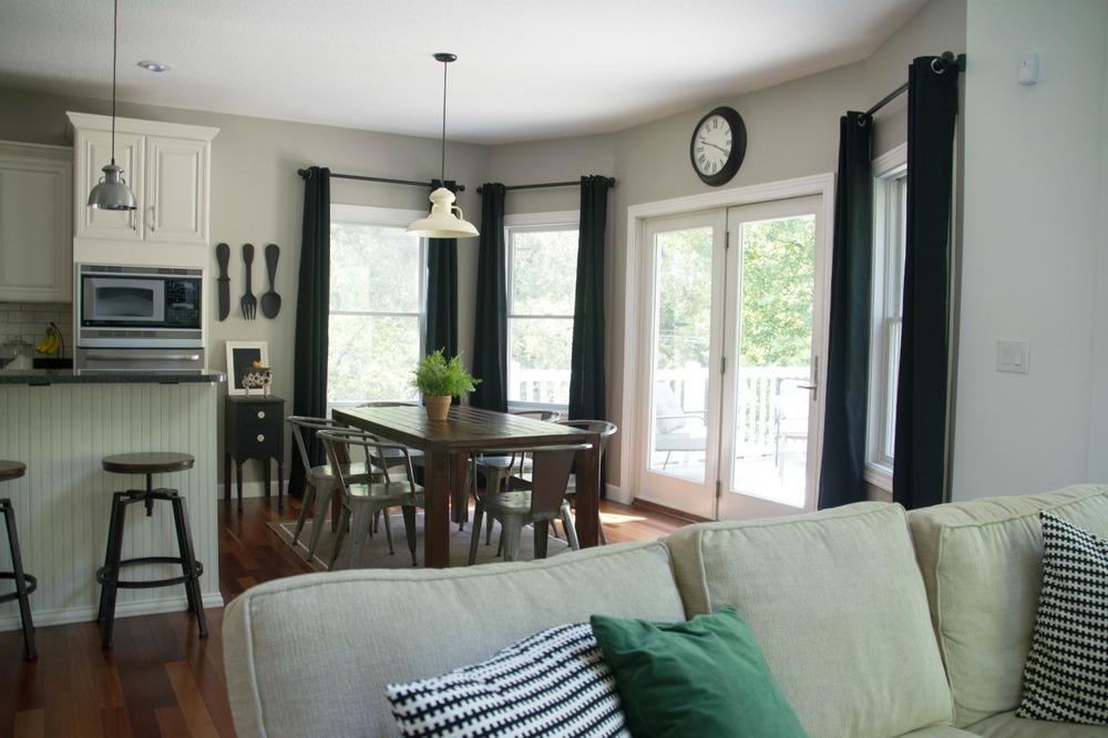 Black curtains.  Farmhouse table.  Barnlight Lights.