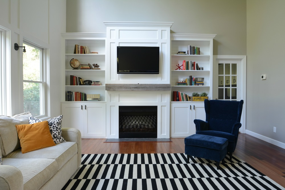 Living Room Updates {IKEA Stockholm Rug} Black, White, Navy. Barn Beam Mantel Built-ins. Books.