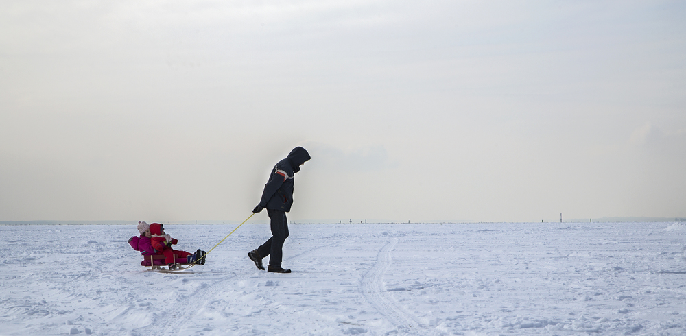 MONTREAL, QC. FEBRUARY 11, 2014 -- A father pulls his two daughters on a sled over the frozen surface of Lac Saint-Louis on a frigid Sunday afternoon in Lachine. (Leslie Schachter/Unpublished)