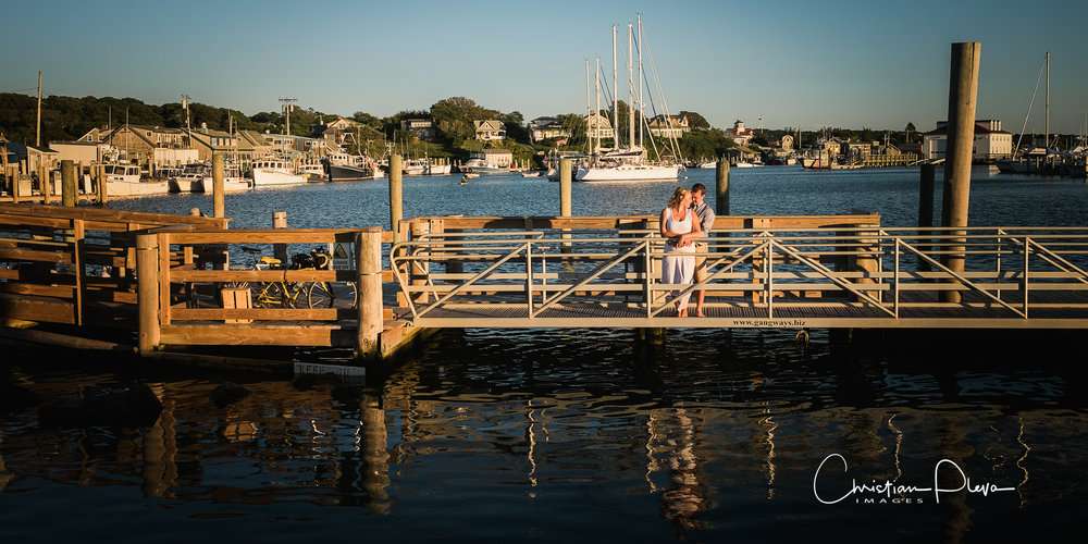 "Tell us the proposal story~ A. We were taking a long weekend trip to Martha's Vineyard over Labor day weekend of 2015. Our first day there was fun-filled with all of our favorite things to do on the island: from our go-to breakfast spot, to the Bad Martha's brewery (where we tried every beer on tap), to our favorite Mexican restaurant -- we were just so excited to be there! Then we headed to our favorite spot to watch the sunset - Menemsha Beach. On our way to Menemsha, Ricky INSISTED we stop at this fancy gift shop to pick up nice wine glasses - which was totally out of the norm for him, and I was getting frustrated because we were cutting it close on time and I just wanted to get there...but he insisted. We finally got to the beach, grabbed some fried seafood and opened a bottle of wine that Ricky picked out and started to watch the sun set...Then Ricky asked me to go down to the water to skip rocks and feel the water - but I was really focused on eating our dinner and enjoying the view. I started to walk up to our chairs (and wine) and he said ""Wait come back - I need to ask you something!"" Right then...I knew and when I turned around he was on one knee and he proposed!"