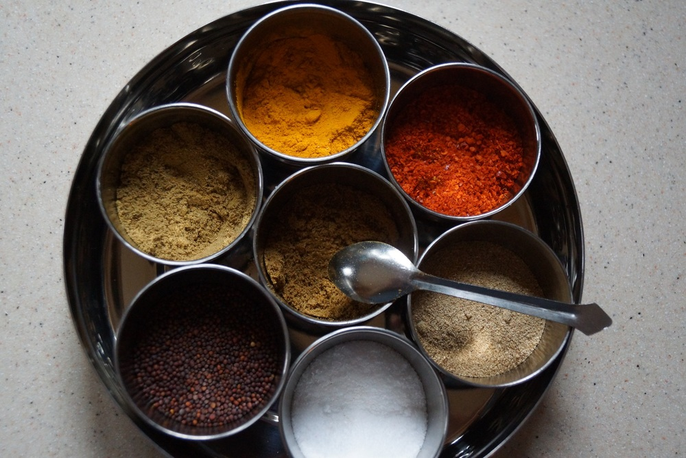 Masala Dabba of Indian Spices - Turmeric, Red Chile, Dried Mango Powder, Salt, Mustard Seed, Coriander, and Cumin