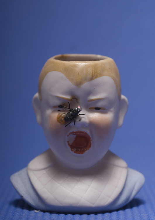 When I first opened shop years ago this was the first thing I ever sold. A small head vase screaming kid with a fly on his face.