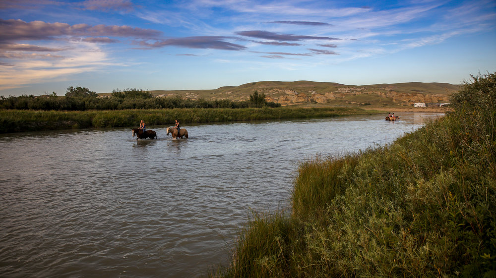Cooling off in the Milk River, Writing-On-Stone Rodeo, 2013