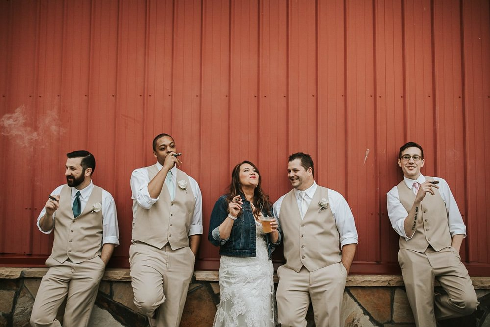 bride-with-groomsmen-smoking-cigars--1.jpg