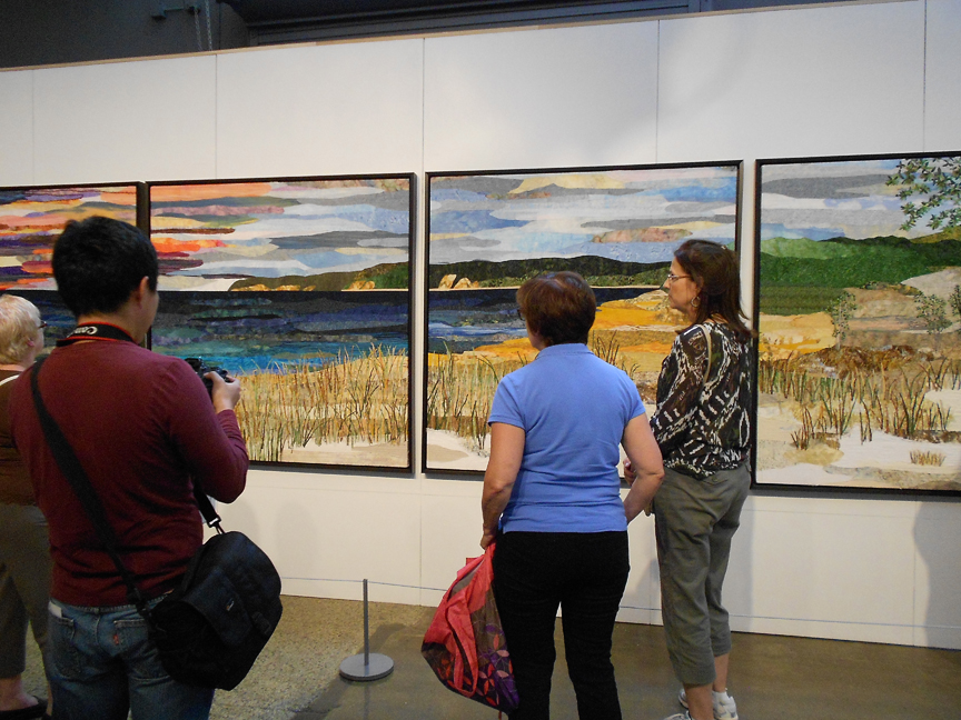 "Michigan artist Ann Lovelace was the grand prize winner of 2013 with her quilt piece ""Sleeping Bear Dune Lakeshore"""