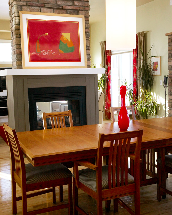 ACCENT COLOURS   The red accent colour is what pulls the living and dining room together. The blonde wood on the artwork is in keeping with the simple lines of the arts and crafts style dining table.