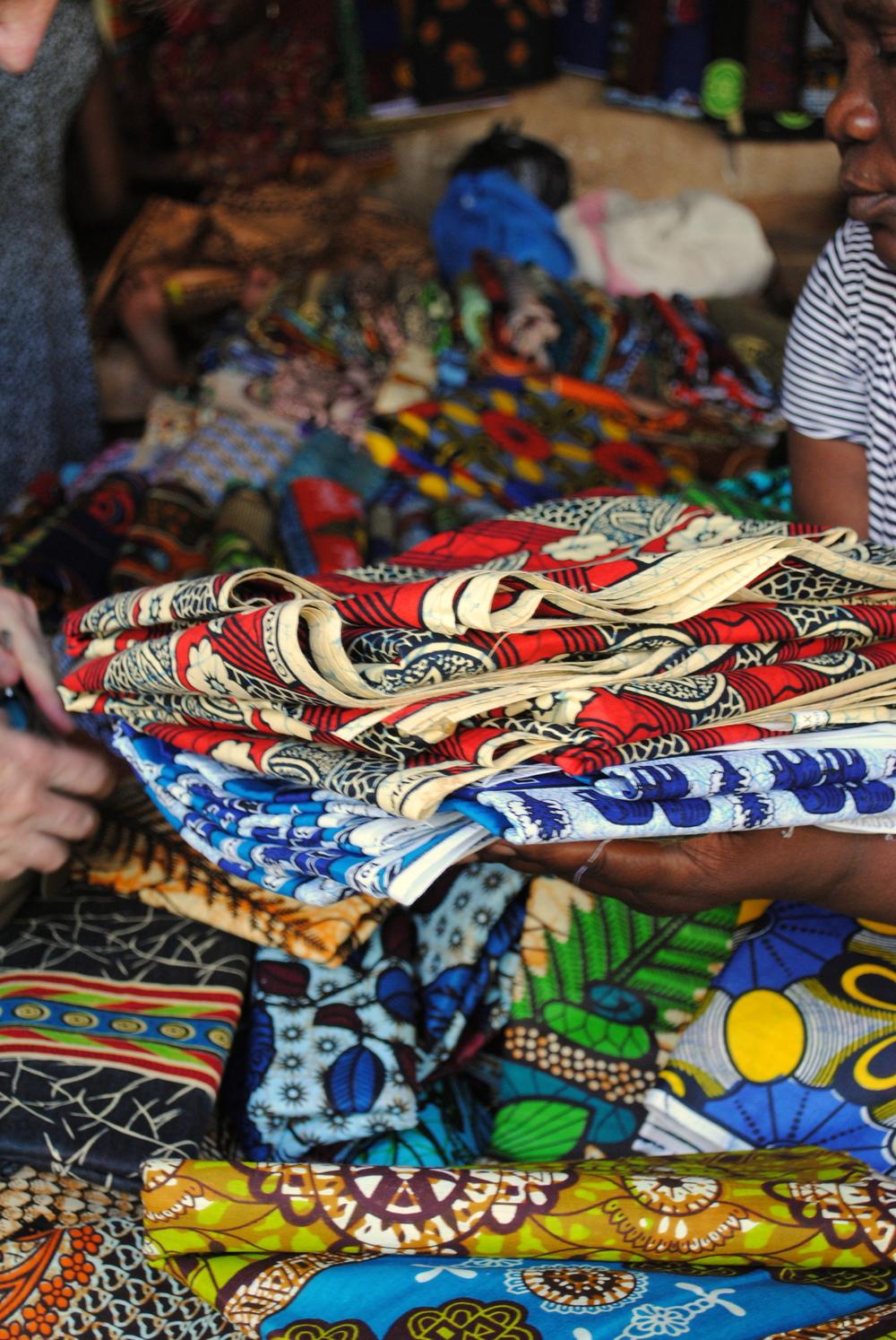 Inspecting chitenji in the Old Market