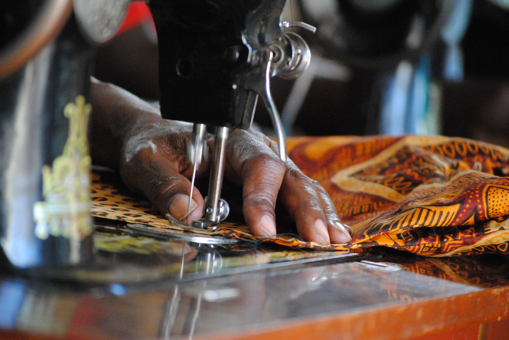 Sewing a dress from raw chitenji stock