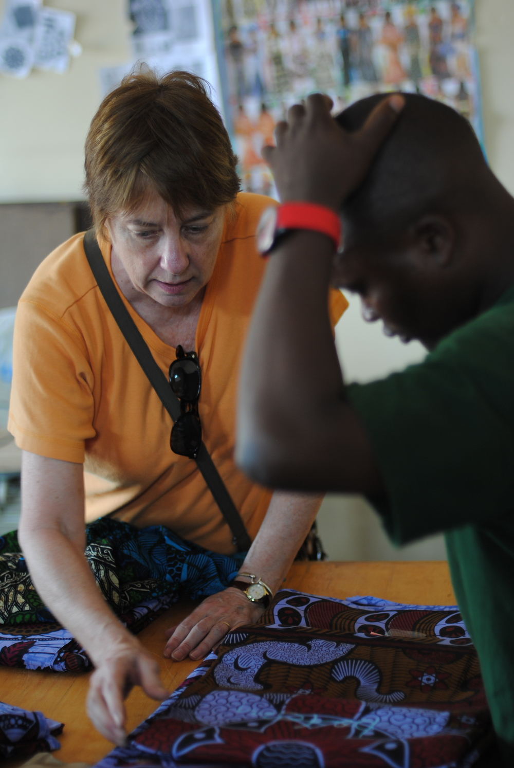 Eileen works with Amos, the head of a sewing collective, to work out how the items will be made.