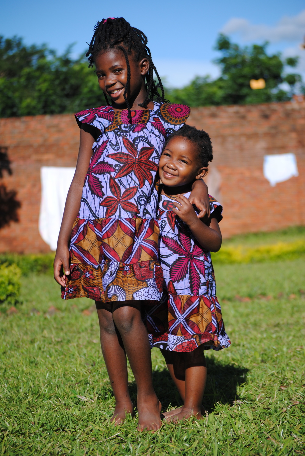 Tatenda and Praise are two Malawian girls who live close to Kasungu. They were kind enough to model our dresses for us!