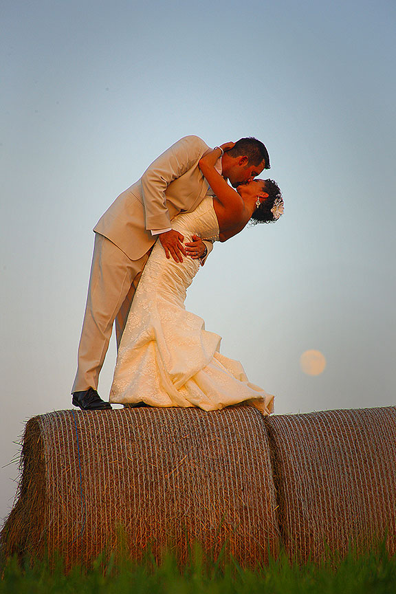Virginia Farm Wedding Bride and Groom on Hay Bale With Moon in Background