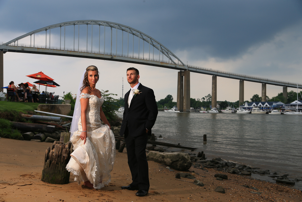 Chesapeake City Maryland Wedding Bride and Groom under Chesapeake City Bridge | Frederick Wedding Photographer