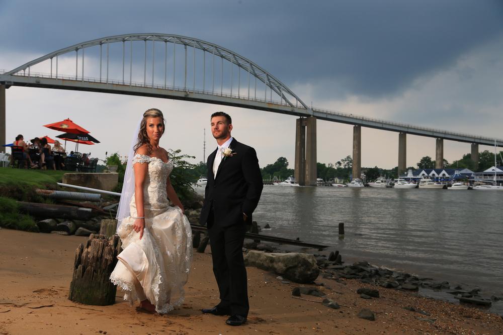 Chesapeake City Maryland Wedding Bride and Groom under Chesapeake City Bridge | Frederick Wedding Photographer