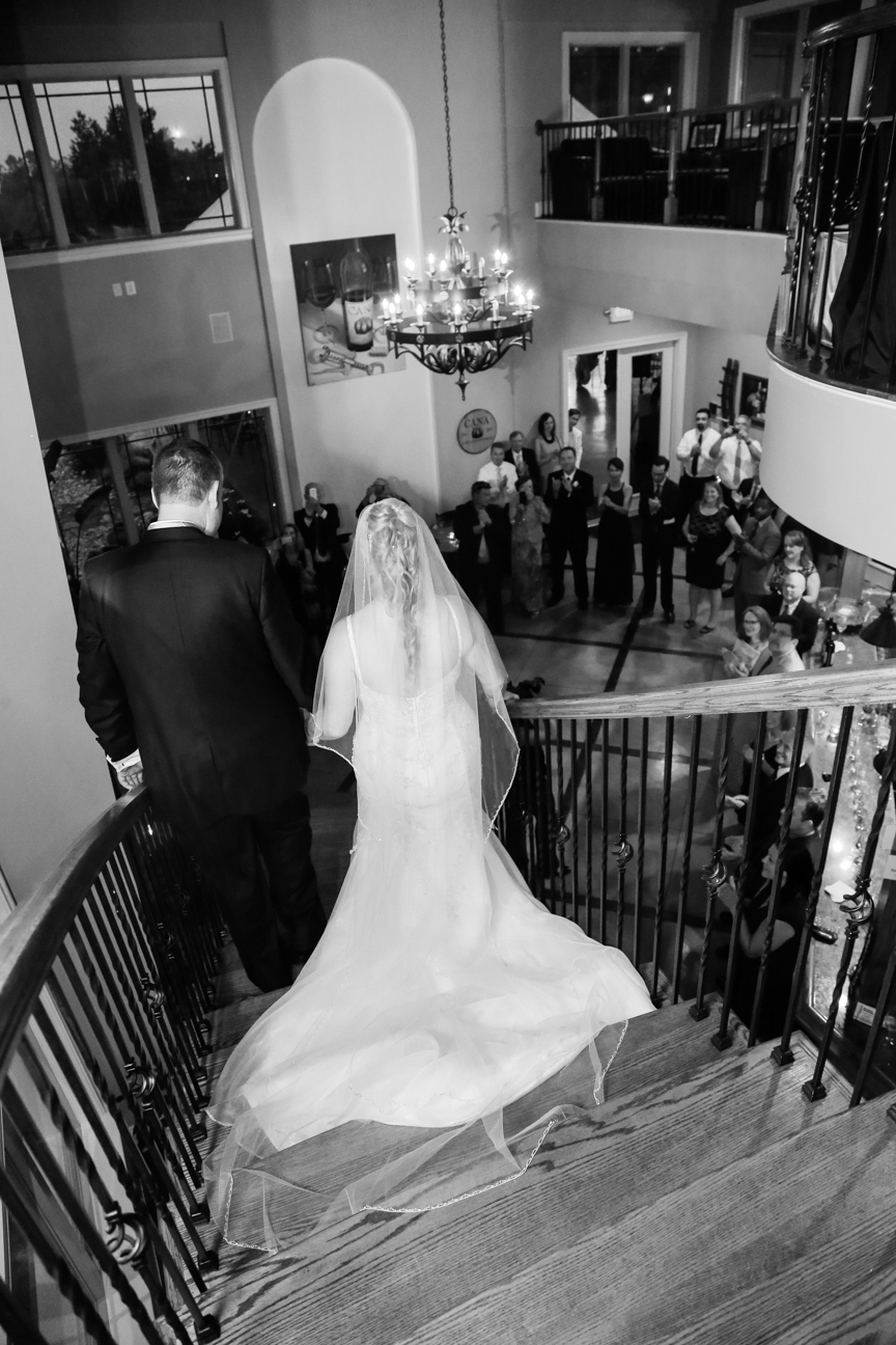 Bride and Groom entering wedding reception room
