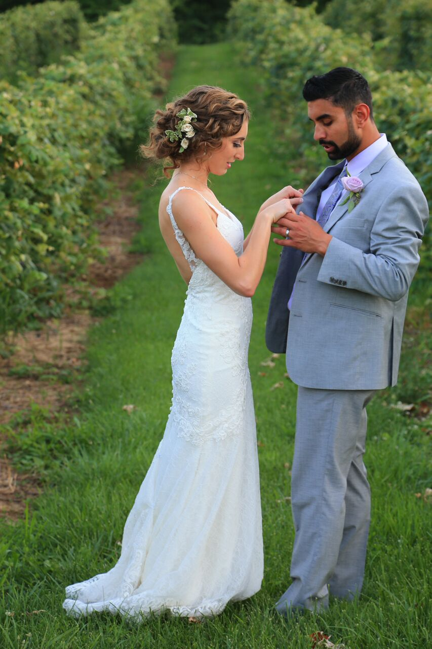 bride and groom in vineyard bluemont winery