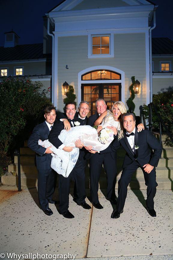 groom groomsmen carrying bride