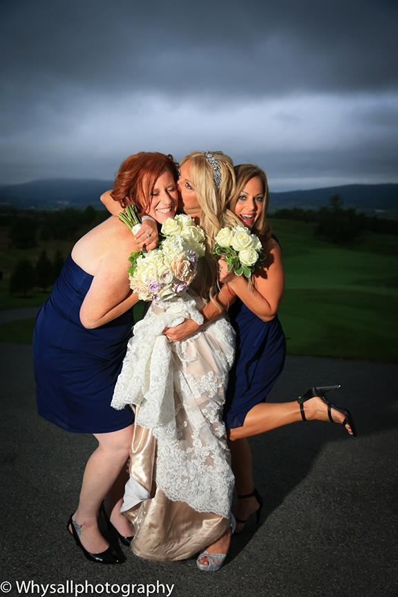 bride and bridesmaids having fun sunset
