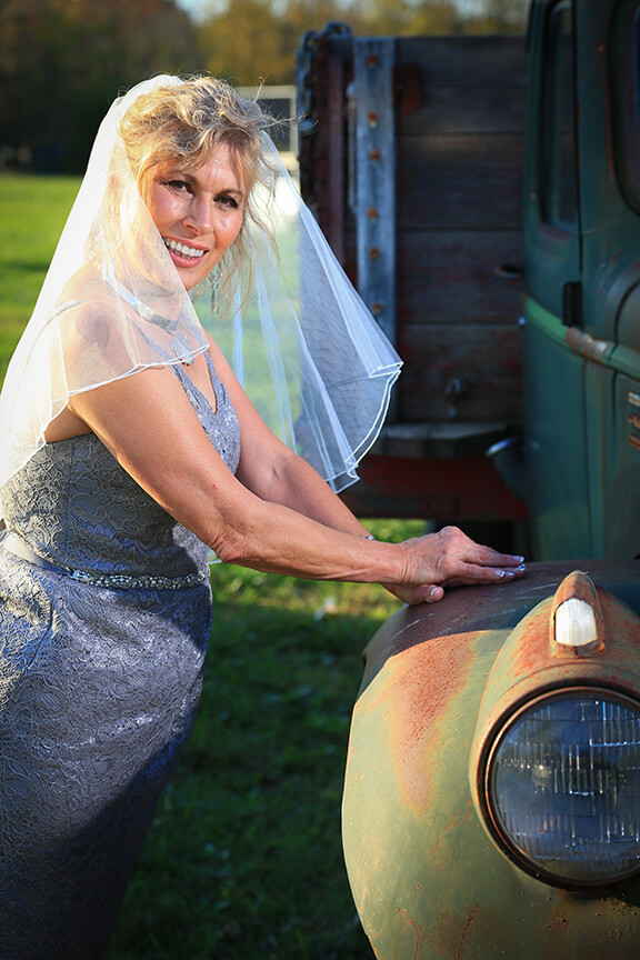 bride on car portrait wv farm