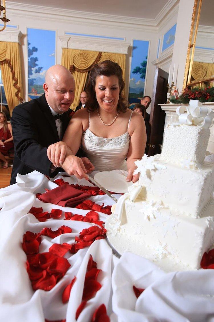 a-christmas-wedding-cake+cutting.jpg