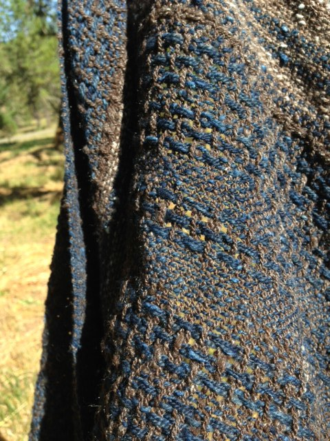 detail from a handspun, handwoven shawl.  naturally colored and indigo dyed // wool and silk   (an award winning, collaborative effort between local         sheep farmers, artisan spinners, and myself)
