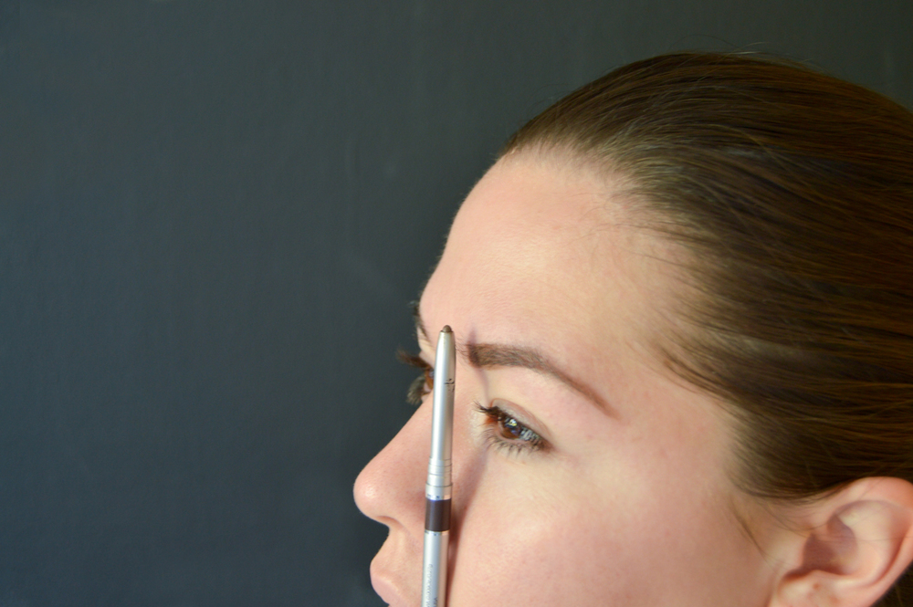 4. Your brow should begin at the corner of the nose. Align pencil vertically along the nostril to guidance.