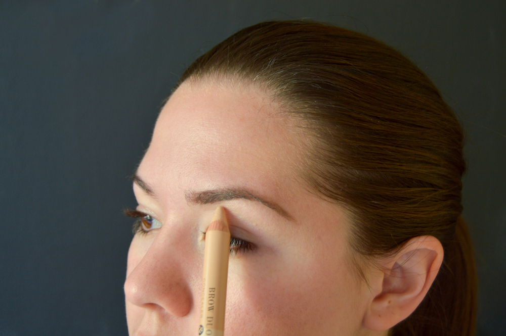6. With the  Brow Duo Pencil touchup any redness around the eye.