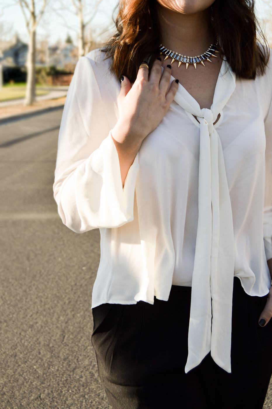 Long tie sheer blouse, spiked necklace, aviators via. Birdie Shoots