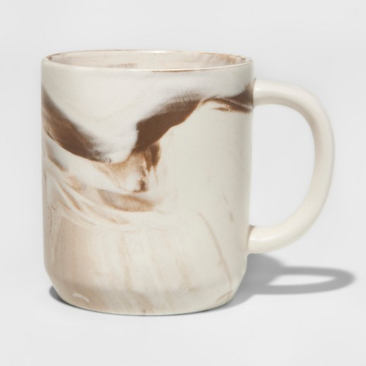 - Stoneware Marbleized MugThe glazed stoneware gives this mug a glossy finish, while the painted swirls add a handcrafted feel for a look that is both polished and one of a kind.