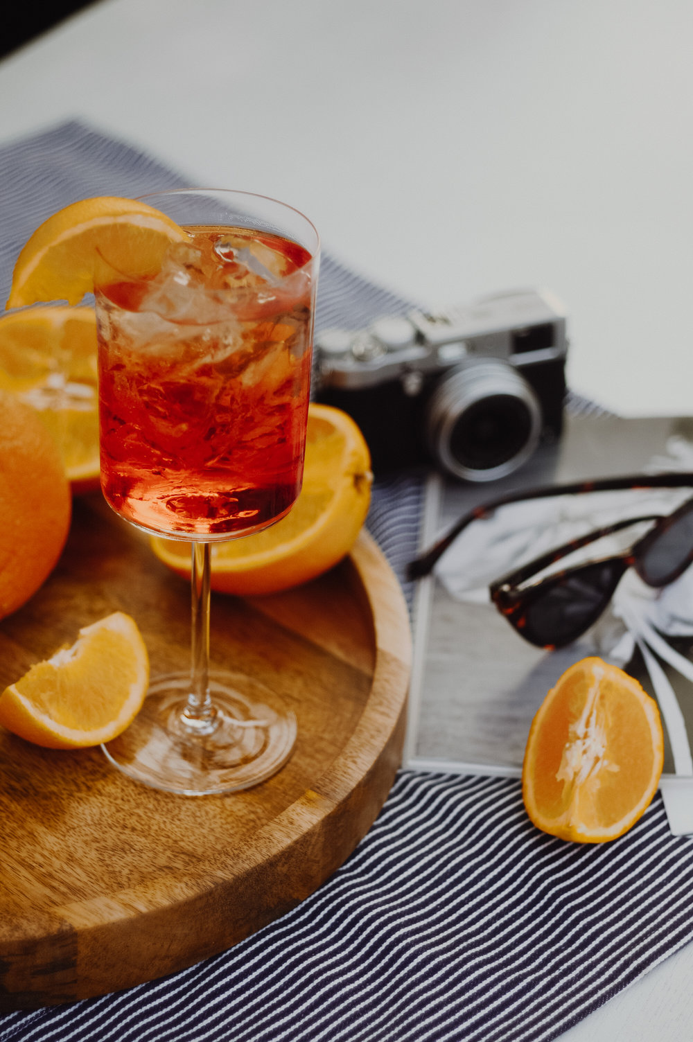 HOW-TO APEROL SPRITZ COCKTAIL - - Ice- Aperol- Prosecco DOC- Soda Water- Orange (sliced)Fill a wine glass with ice chips. Next, pour equal parts Prosecco and Aperol. Add a dash of soda water, being careful not to overfill the glass. Garnish with orange slice and enjoy!