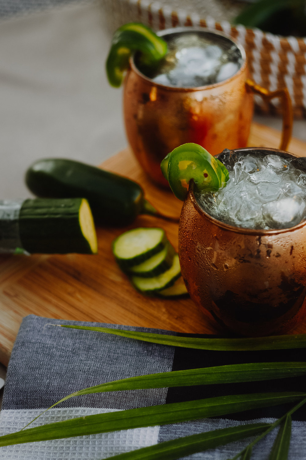 How To: Jalapeño-Cucumber Mule - - 1.5 oz Smirnoff No. 21 Vodka infused with cucumbers and jalapeños - 3 oz Ginger Beer- 0.75 oz Fresh Lime Juice (half squeeze)- 1 jalapeño slice- 1 cucumber sliceTo kick things off, start by influsing Smirnoff* No. 21 Vodka with 10-20 sliced cucumbers and 1 diced jalapeños (seeds removed), around 30-45 mins (longer if you prefer additional kick). Once the vodka has been successfully infused, add 1.5 oz. into a copper mule mug. This is the best cup for a Moscow Mule, since the metal quickly takes on the icy temperature of the cocktail! Next, add 3 oz. of quality ginger beer. Top things off with a squeeze of fresh lime, stir, and top with crushed ice. For fun, garnish with 1 jalapeño and 1 cucumber slice.