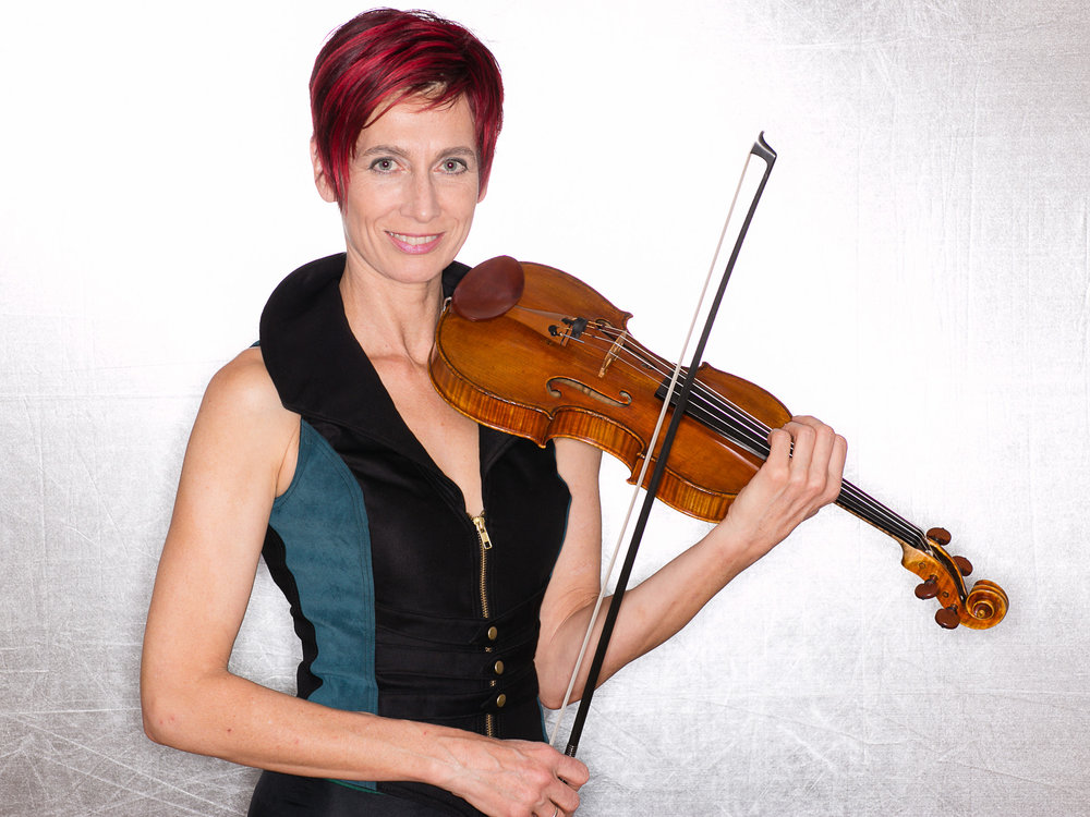 For more information about me as a composer and violinist, please visit my primary musician website at gloriajustenmusic.com.