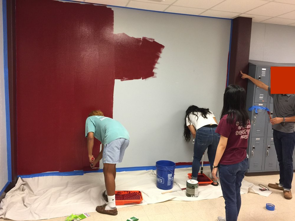 Painting begins. A day later random passersby are buzzing about the maroon wall.