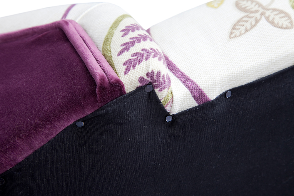 Black cotton bottoming cloth is secured with traditional fine tacks to the underside of all pieces