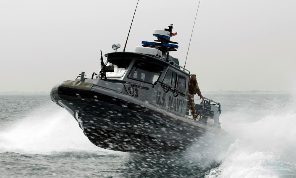 US_Navy_090210-N-9671T-144_A_port_security_boat_patrols_the_waters_near_Kuwait_Naval_Base.jpg