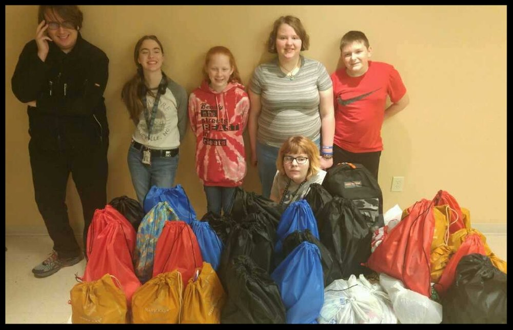 YOUTH GROUP at faithOur youth are busy at FAITH doing service projects and enjoying fellowship. Here are Nick, Sarah, Ava, Hannah, Isaac, and Leah in the middle of the items they collected and bagged for foster children. All children in our community attending the 6th through 12th grades are invited to attend--check calendar for the next meeting! -
