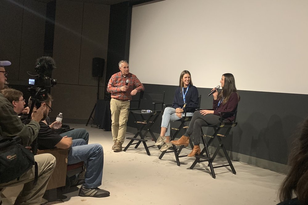 Ragged Mountain Running Shop's Mark Lorenzoni leads a panel discussion with director Marion Mauran and producer Cecily Mauran.