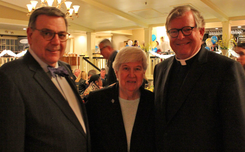 From left are Sacred Heart University President Dr. John J. Petillo, Caroline House Executive Director Peg Regan, SSND, and Fairfield University President Rev. Jeffrey von Arx, S.J.