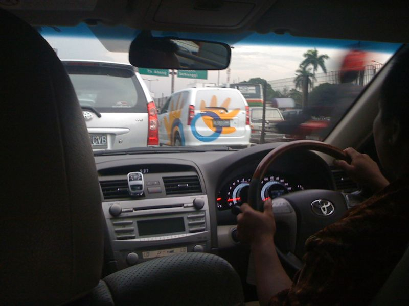 A friendly new face in early morning rush hour traffic - Telkom Indonesia, Jakarta