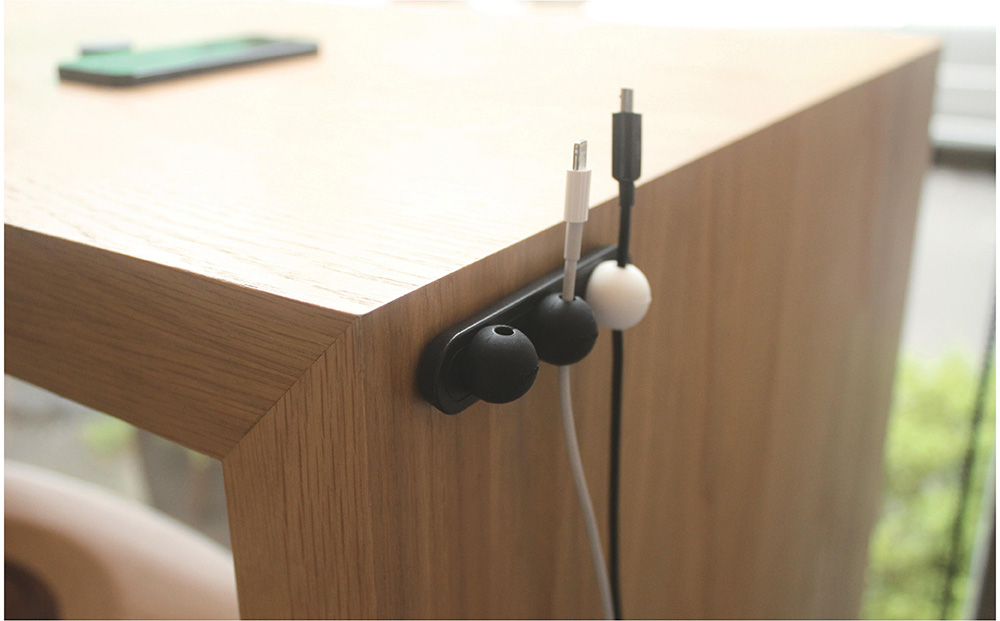 Lead Trend Magnetic Cable Holder Plus A simple magnetic strip to hold your cables on your desk or wall, the Lead Trend Magnetic Cable Holder Plus is a minimalistic solution to your cable management needs.  Available with different coloured dots and in strip or pebble form. More info.