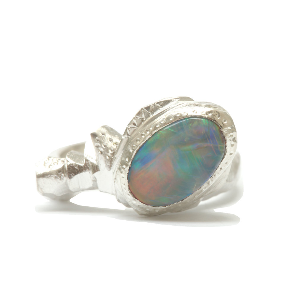 Leila's Ring. A christmas commission for Leila from her mother, using the client's own opal and set in sterling silver. This pieces is designed to stack in with a ring she already had, shown below.