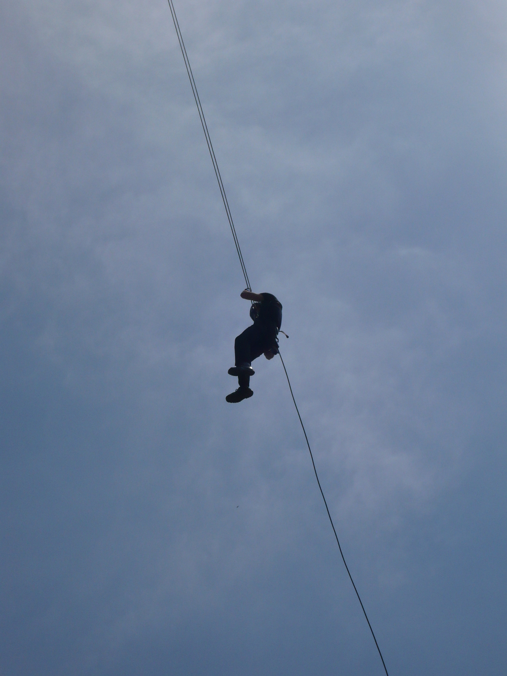 Feeling the exposure on a free space abseil..
