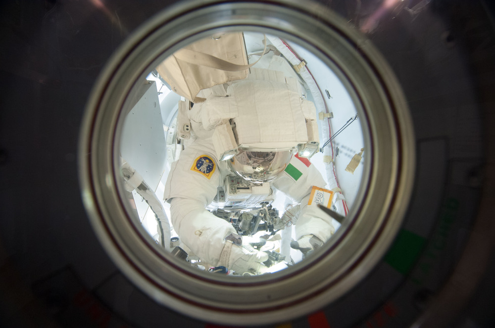 Wide-angle view of Luca Parmitano seen through the small window of the Space Station's Quest airlock... Copyright ESA/NASA