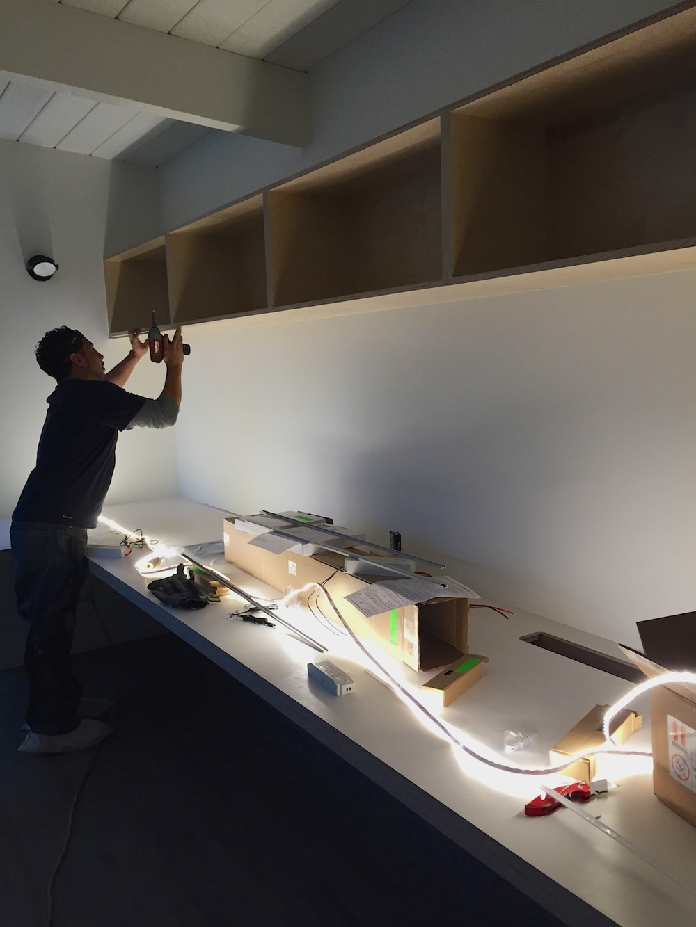 Installing high output LED strip light at upper office shelving