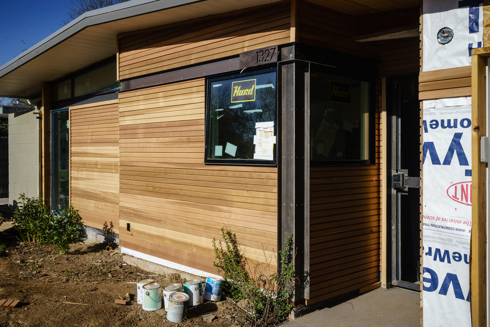 Cedar siding with steel detailing at entry