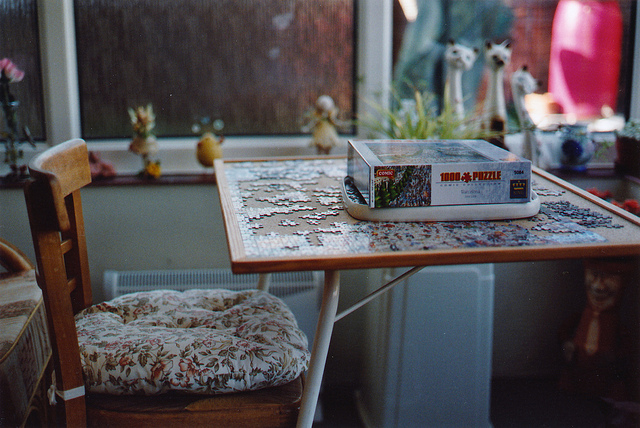 Unfinished puzzle  on Flickr.  I took this photo a few months ago, it was at my nan's house.  We'd just scattered my mum's ashes.  I took it knowing my nan didn't have long either.   My nan died at the weekend, and I'm having the same confusing thoughts and feelings as I had last September when my mum died.  For most of my childhood, I was closer to my nan than anyone else.  She treated me and Simon so well, taught us about exploring, inventing, making stuff out of nothing and above all having fun.  The last time I saw her, a few months ago, she was still the playful, cheeky person I remembered.   But, there was a big black hole in our relationship.  She pretty much disappeared out of our lives when we were about 13, at a time we needed her more than ever.  Simon and myself were left to look after our mentally ill mum until it got so bad we had to leave home.   That last bit sounded a bit 'woe is me', I didn't mean it to.  I am able to see a whole lot of positive things that came out of those times.  I guess the death of family members brings up all sorts of memories, good and bad.   I don't hate my nan for the black hole, I kind of understand why it happened.  I'm just upset I didn't have the chance to spend much of my adult life with her.  At Christmas, we made her a book with photo's of the adventures Simon and myself had got up to over the past ten years.  I hope she enjoyed sharing some of those memories with us.