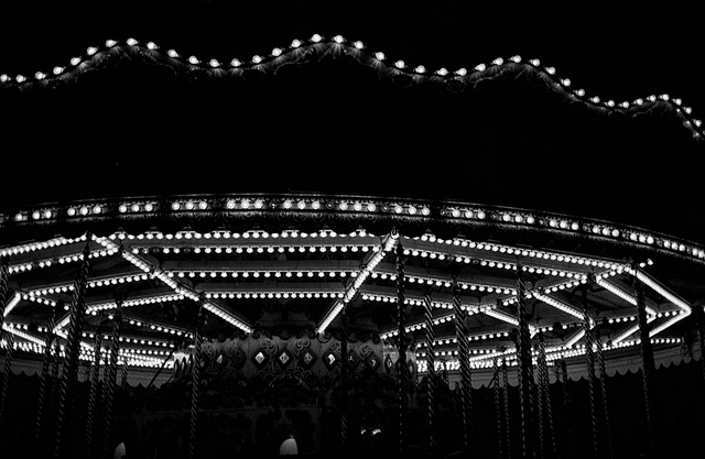 Merry  on Flickr.  Taken on the Palace Pier in Brighton, on a slightly drunken night out.